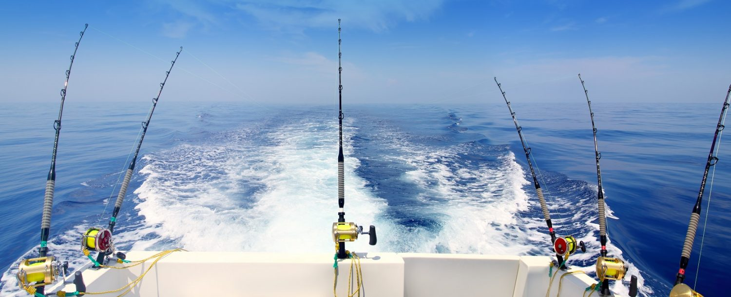 Boat trolling the sea with rod and reels